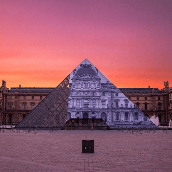 "French artist JR's latest installation, ""Raising Questions"", at the Louvre in Paris."