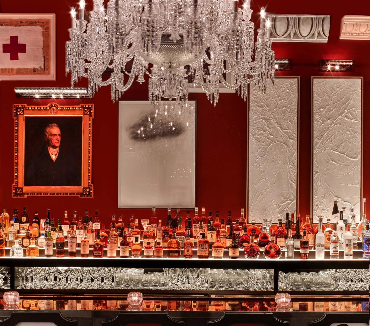 A crystal chandelier over the bar at Baccarat hotel