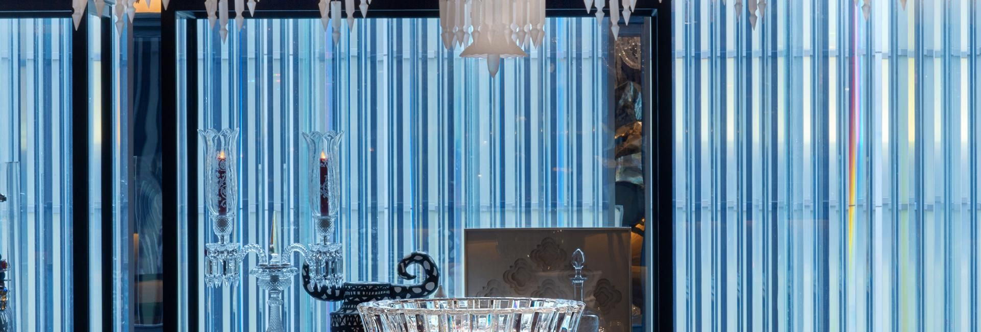 A crystal chandelier above a table at Baccarat hotel